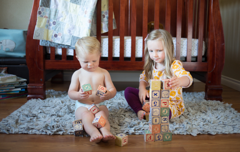 brother and sister playing with blocks