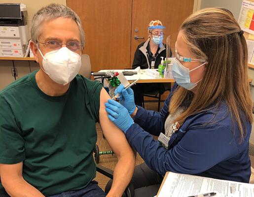Provider receiving COVID-19 vaccine.